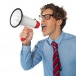 Young businessman using megaphone — Stock Photo #9832633