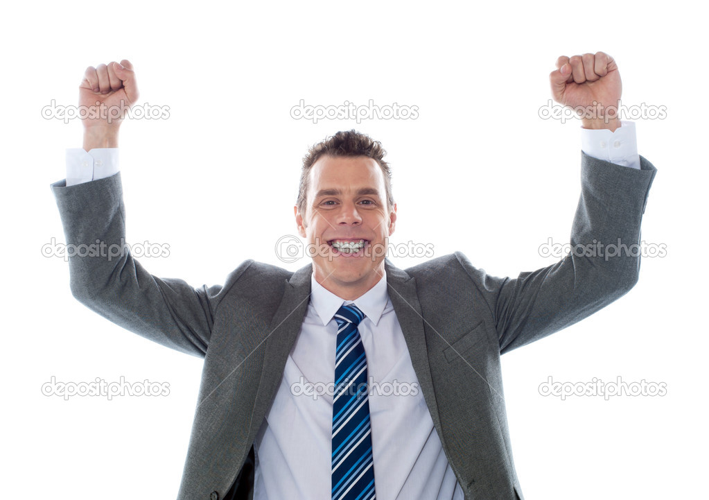 Cheerful excited business executive posing with arms up isolated over white — Stock Photo #9914987