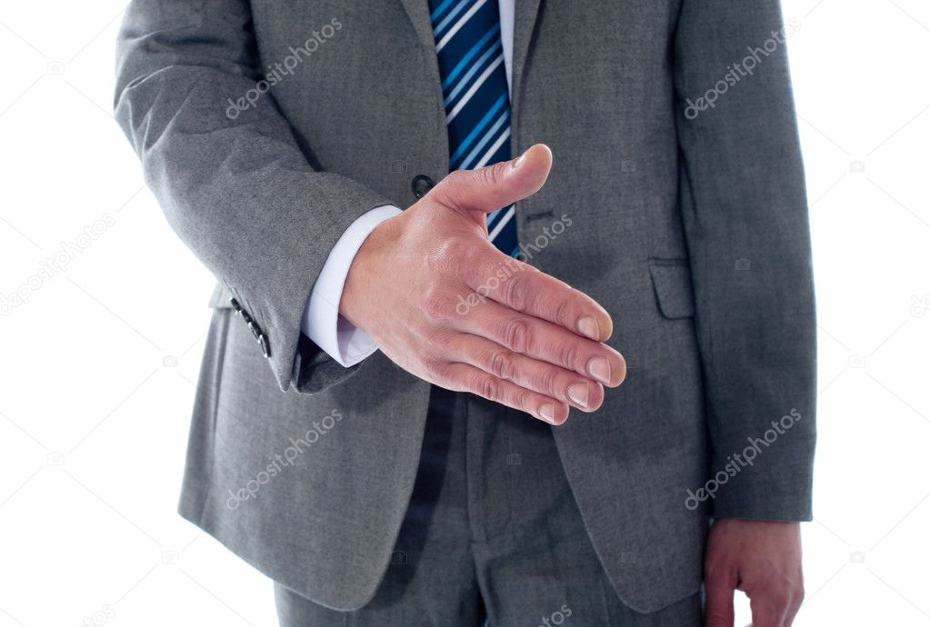Business deal, close-up shot. Businessman offering handshake  Stock Photo #9914994