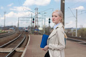 Girl waiting for the train — Stock Photo