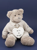 Teddy bear boy with a heart — Stock Photo