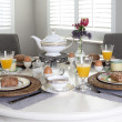 Foto Stock: Dining table laid for breakfast