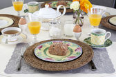 Dining table with breakfast — Stock Photo