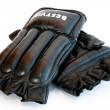 Black sports fight gloves on a white background — Stock Photo