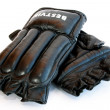 Black sports fight gloves on a white background — Stock Photo #9783397