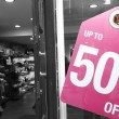 Sale signs in shop window — Stock Photo
