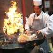 Chinese chefs work at the Chinese New Year celebrations - Stock Photo