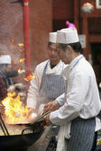 Chinese chefs work at the Chinese New Year celebrations — Stock Photo