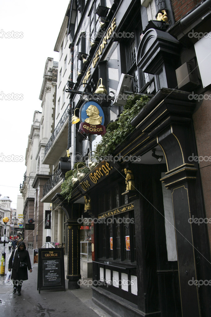 London, UK - May 08, 2010: Outside view of a public house, known as pub, for drinking and socializing, is the focal point of the community, Pub business, now about 53,500 pubs in the UK, has been declining every year.  Stock Photo #9730248