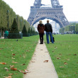 Foto Stock: Couple tourist watching Eiffel Tower in distance.