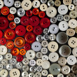 Stock Photo: Colorful buttons in shape of heart on black background