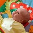 Stock Photo: Little baby playing on mat