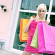 Stock Photo: Young blonde shopping woman with bags