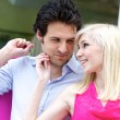 Young attractive couple in shop — Stock Photo #10016908