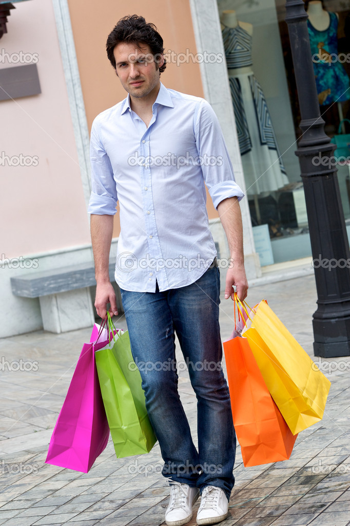 Attractive young man with shopping bags, Tuscany Italy — Stock Photo #10017333