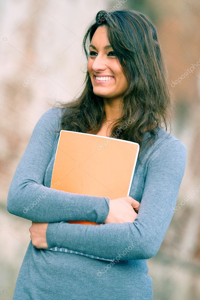 Portrait of  young ,brunette,woman student in the park,Pisa Italy — Stock Photo #10029286