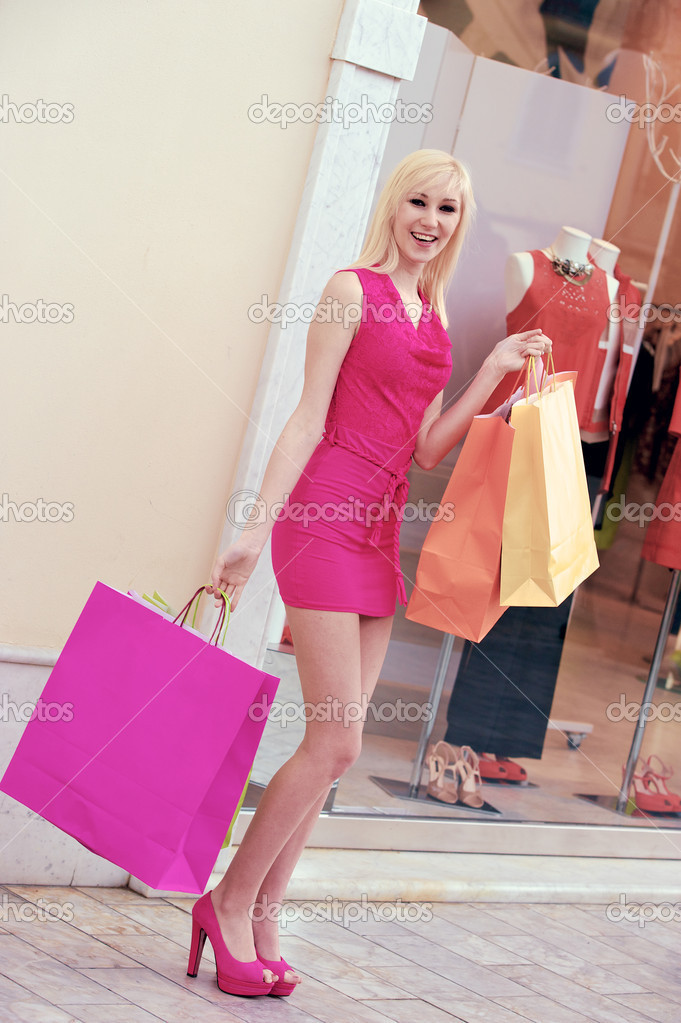 Young blonde shopping woman with bags ,Tuscany Italy  Stock Photo #10216434