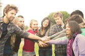 Multiracial Students whit hands on stack — Stock Photo