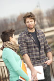 Happy young couple of students — Stock Photo