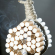 Hang himself with cigarettes - Stock Photo