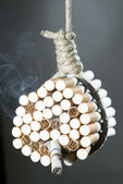 Hang himself with cigarettes — Stock Photo