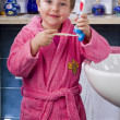 Little girl brushes her teeth — Stock Photo