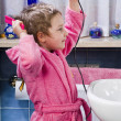 Girl dries her hair with hair dryer — Stock Photo