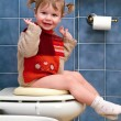 Stock Photo: Child on toilet