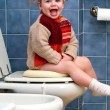 Stock Photo: Child on the toilet
