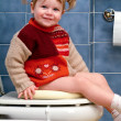 Royalty-Free Stock Photo: Child on the toilet
