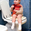 Child on the toilet — Stock Photo #10035917