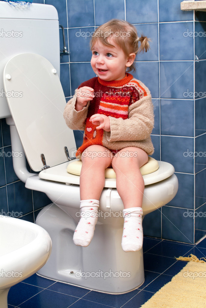 Little girl on the toilet that makes funny faces  Stock Photo #10035917