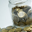 Jar and coins — Stock Photo