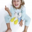 Girls in pajamas shows the middle finger — Stock Photo