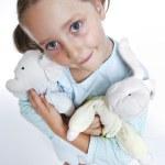Smiling girl in pajamas — Stock Photo