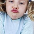 Girls in pajamas makes faces — Stock Photo
