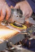 Grinding wheel cutting iron — Stock Photo