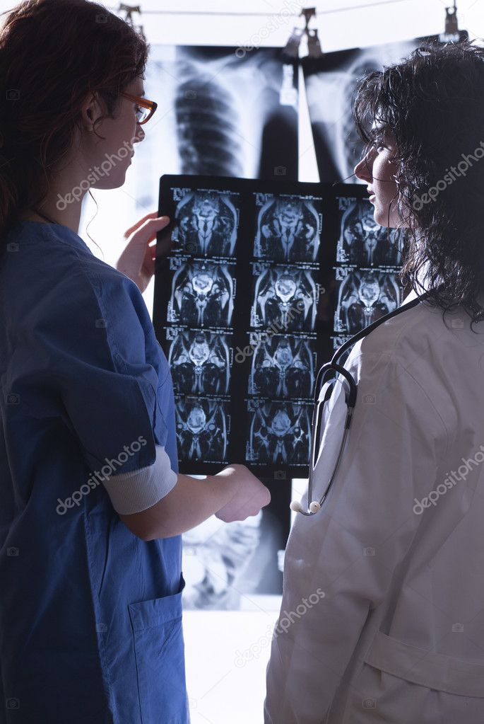 Doctors examining different radiographs in their study — Stock Photo #10485144