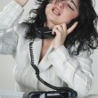 Business woman answering the phone — Stock Photo