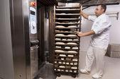 Baker makes the bread — Stock Photo