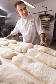 Baker makes the bread — Stock Photo