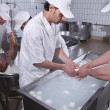 Stock Photo: Dairymen, who prepare the mozzarella
