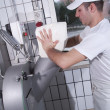 Dairymen, who prepare the mozzarella - Stock Photo