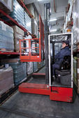 Forklift in a warehouse — Stock Photo