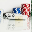 Ace king with poker chips over white — Stock Photo