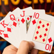 Royal flush cards holding in hands — Stock Photo