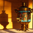 Grandma's old samovar at sunset — Stock Photo
