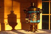 Grandma's old samovar at sunset — Stock Photo