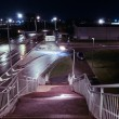 Stock Photo: View from railroad bridge at night