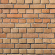 Seamless tile pattern of a clay brickwall — Stock Photo